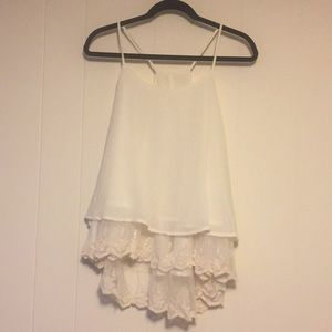 Cream spaghetti strap tank with lace trim